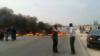 Protesters in Borazjan township in Iran block a roadway by burning tires. November 16, 2019