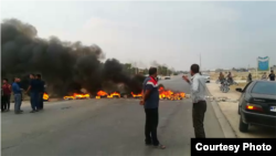 Protesters in Borazjan township in Iran block a roadway by burning tires. November 16, 2019