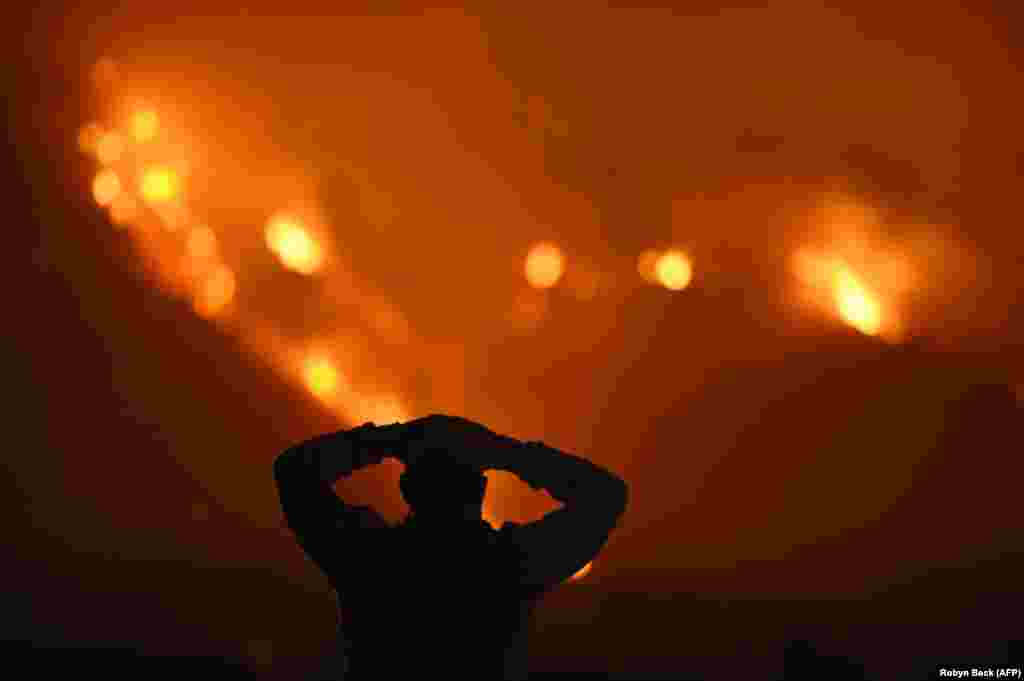 A man watches the Thomas Fire in the hills above Carpinteria, California, on December 11. The Thomas Fire in California's Ventura and Santa Barbara counties has consumed more than 93,000 hectares over the past week, making it the fifth-largest fire in the state's history. (AFP/Robyn Beck)