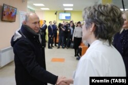 Putin visits a local children's clinic in the town of Usman in the Lipetsk region on January 22.