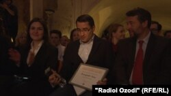 Jamshed Yorov holds the award after the ceremony in Prague on March 5.
