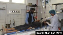 An Afghan man is treated at a hospital following an air strike in Kunduz on April 2.