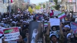 Government Supporters Shown On Iran's Streets In Wake Of Protests