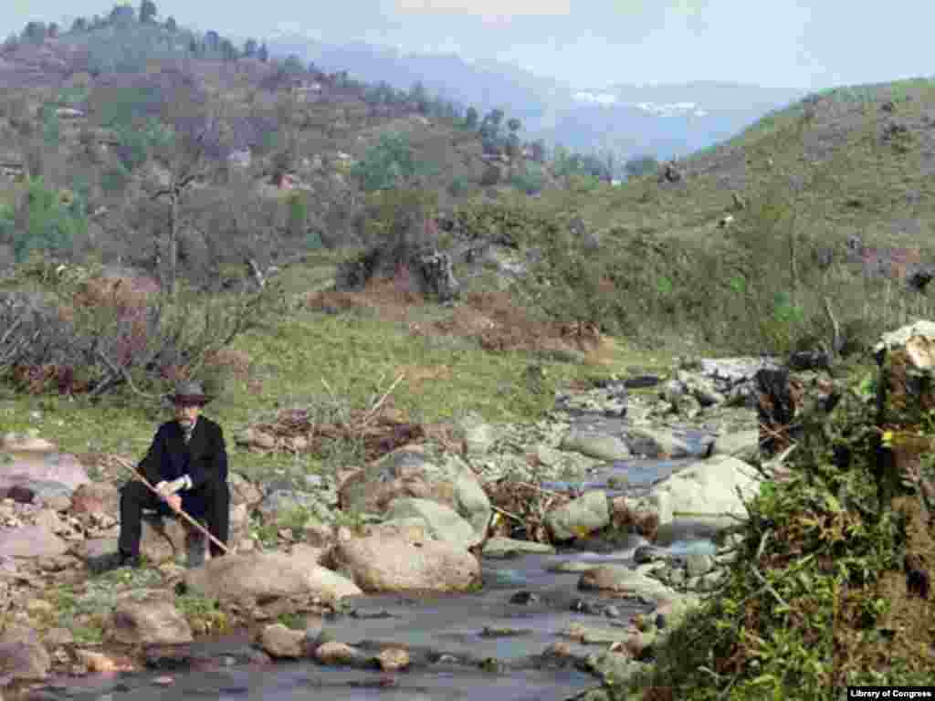 Sergei Mikhailovich Prokudin-Gorsky poses near a mountain stream in the Caucasus. - At the start of the 20th century, photographer Prokudin-Gorsky won the support of Tsar Nicholas II to conduct an ambitious photographic survey of the Russian Empire.