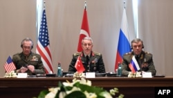 Turkey's Chief of Staff General Hulusi Akar (center) meets with U.S. Chairman of the Joint Chiefs of Staff Joseph Dunford (left) and Russian Armed Forces Chief of Staff Valery Gerasimov in Antalya on March 7.