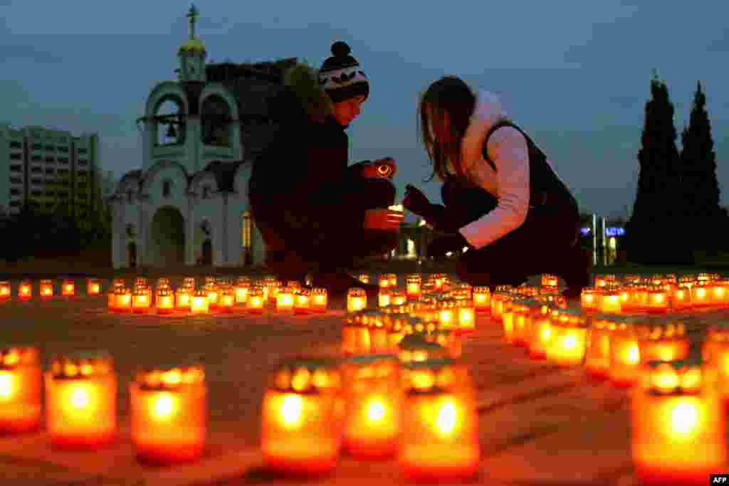 Women place candles near an Orthodox church in Minsk to protest against abortion, which is legal in Belarus. (AFP/Sergei Gapon)
