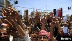 Antigovernment protesters shout slogans during a rally to demand the ouster of Yemen's President Ali Abdullah Saleh in Sanaa in late September.