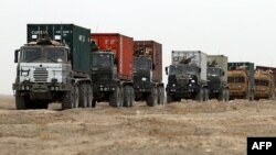 A convoy of British military vehicles moves through southern Afghanistan's Helmand province.
