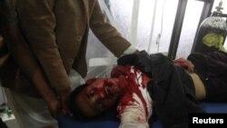 Раненый протестующий, Сана, 18 марта 2011