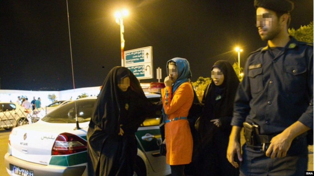 "An Islamic Guidance patrol arresting young Iranians for ""immoral behavior"". File photo."