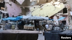 Empty vegetable stalls are pictured in Aleppo's rebel-controlled Bustan al-Qasr neighborhood due to a siege by Syrian pro-government forces on August 5.