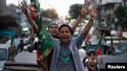 Supporters of Imran Khan's Justice Movement rally on the last day of campaigning in Karachi on May 9.