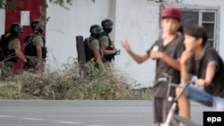 Soldiers secure an area during an antiterrorist operation aimed at eliminating armed militants in a Bishkek neighborhood on July 16.