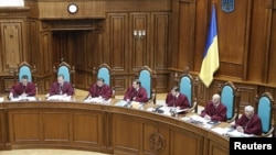 Judges of Ukraine's Constitutional Court attend a hearing on constitutional reform in Kyiv.
