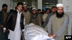 Relatives wheel the body of Pakistani lawyer Samiullah Afridi after he was shot dead in Peshawar on March 17.