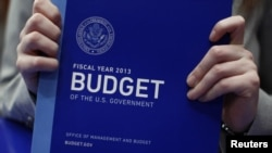 U.S. -- A staff assistant holds a copy of President's FY2013 budget upon its arrival at the Senate Budget Committee room on Capitol Hill in Washington, DC, 13Feb2012