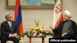 Iran - President Hassan Rohani (R) meets with his visiting Armenian counterpart Serzh Sarkisian in Tehran, 5Aug2013.