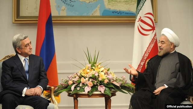 Iran - President Hassan Rohani (R) meets with his visiting Armenian counterpart Serzh Sarkisian in Tehran, 5Aug2013.
