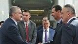 Российский глава Крыма Сергей Аксенов (слева), глава парламента Крыма Владимир Константинов (по центру) и президент Сирии Башар Асад (справа)