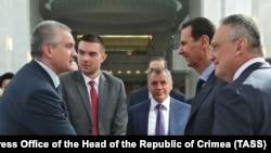Сергей Аксенов (л) и Башар Асада (п) на встрече в Сирии