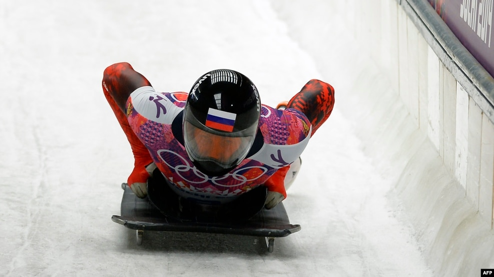 Russia's bobsledder Sergei Chudinov competes Sochi Winter Olympics, February 15, 2014