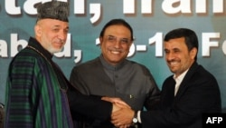 Pakistani President Asif Ali Zardari (center) shakes hands with his Afghan and Iranian counterparts, Hamid Karzai (left) and Mahmud Ahmadinejad, after a joint press conference at the Presidential Palace in Islamabad on February 17.
