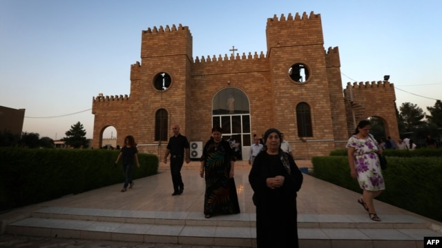Iraqi Christians leave St. Joseph's Church after a mass in Irbil,  the capital of the autonomous Kurdish region, on July 20.