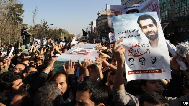 Mourners carry the coffin of Iranian nuclear scientist Mostafa Ahmadi-Roshan during his funeral in Tehran in January.