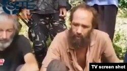 Kanađanin Robert Hol i Norvežanin Kjartan Sekingstad na snimku Abu Sayafa