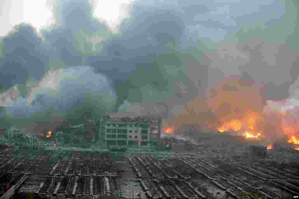 A general view of the destruction after massive explosions destroyed large parts of the port area of Tianjin in northern China. At least 104 people were killed, with hundreds injured and some still unaccounted for. A rapid succession of explosions — one equal to 21 tons of TNT which was felt by earthquake monitors and seen by satellites in outer space — were sparked by a fire in what authorities said were shipping containers containing hazardous material at a warehouse. (epa)