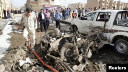 Взорванный смертником автомобиль в Ираке (архивное фото, Киркук, 2013 г.)