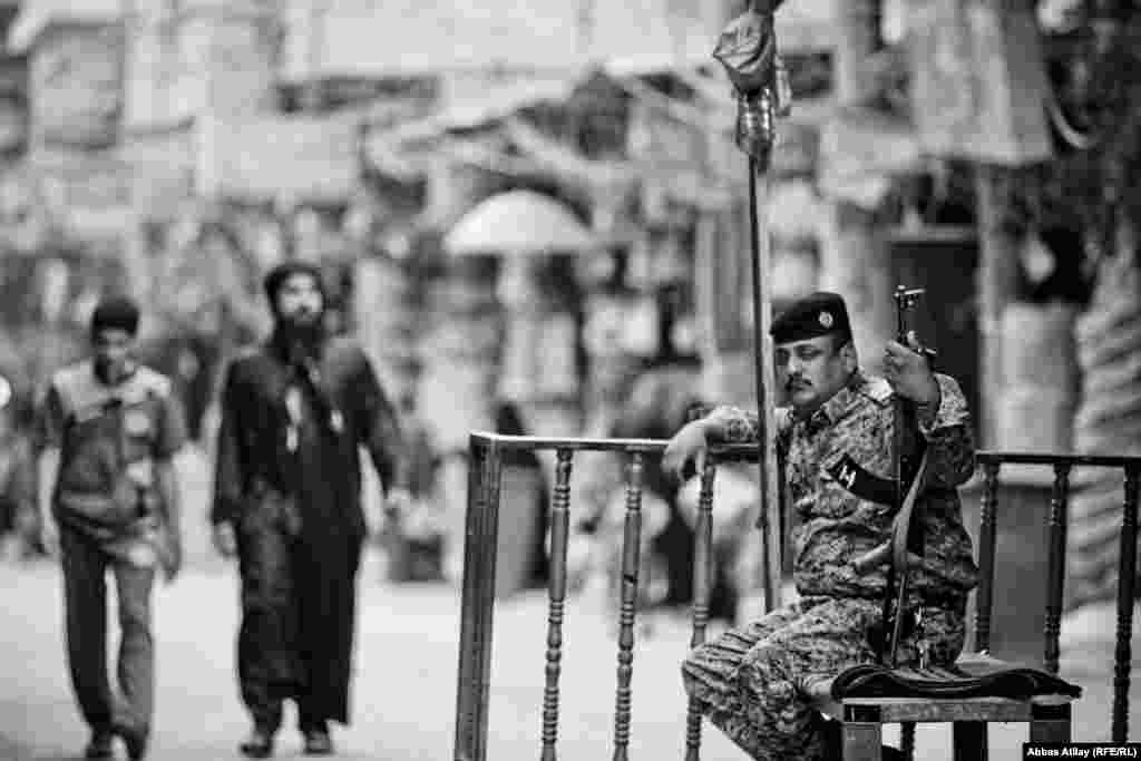 A soldier stands guard at a checkpoint in Karbala, one of countless security points in Iraq.