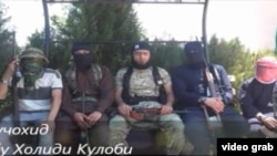 Скриншот видеоролика, в котором рассказывается о воюющих в Сирии таджиках.