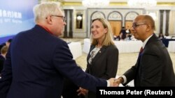 Russian Deputy Foreign Minister Sergei Ryabkov (left) greets U.S. Undersecretary of State Andrea Thompson (center) and U.S. envoy to the Conference on Disarmament Robert Wood in Beijing on January 30.