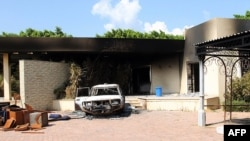 A burnt house and a car are seen inside the U.S. diplomatic compound in Benghazi, Libya, which was attacked by Islamist militants last year.