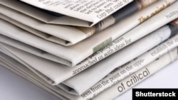 Generic – Detail of a pile of international newspapers