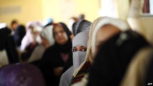Egyptian women queue at a polling station in central Cairo to cast their vote on a new constitution supported by the ruling Islamists but bitterly contested by a secular-leaning opposition on December 15.