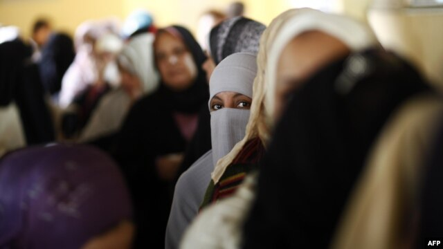 Women at a polling station in central Cairo in December 2012