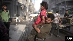 A fighter injured in the Arqub neighborhood of northern city of Aleppo is brought to a hospital on October 1.