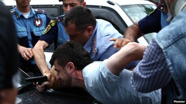 Armenia - Hayk Kyureghian is overpowered by police officers after firing gunshots outside a court in Yerevan, 12Jun2014.
