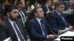 Armenia - Davit Sanasarian (L), head of the State Oversight Service, and Artur Vanetsian (R), director of the Natonal Security Service, at a cabinet meeting in Yerevan, February 21, 2019.