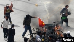 Protesters burned a Chinese flag during demonstrations in the Tibetan capital, Lhasa, in March 2008.
