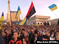 Tens of thousands crowd into Kyiv's Independence Square on March 14 to mark Defenders Day.