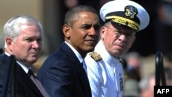 U.S. President Barack Obama (center) was flanked at a tribute in June by outgoing Defense Secretary Robert Gates (left) and Admiral Mike Mullen, both of whom concluded the repeal wouldn't harm the military.
