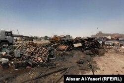 На місці вибуху на базарі міста Ан-Наджаф, 16 червня 2013 року