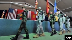 Kyrgyz soldiers parade together with U.S. servicemen during a change of command ceremony at the U.S. transit center at Manas Airport in June. Russia has long been unhappy about the United States' presence in Kyrgyzstan.