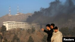 Smoke rises from the Intercontinental Hotel on January 21 hours after the attack had ended,