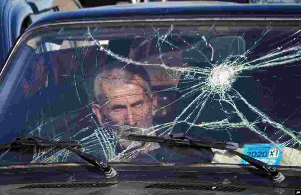 A man waits in his car at a checkpoint as he leaves Nagorno-Karabakh at the border with Armenia. (AP)