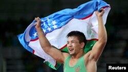 Елмурат Тасмуратов, этнический казах из Узбекистана, после победы в схватке за бронзу Олимпиады. Рио-де-Жанейро, 14 августа 2016 года.