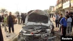 Место взрыва бомбы в Багдаде 27 января 2011 года